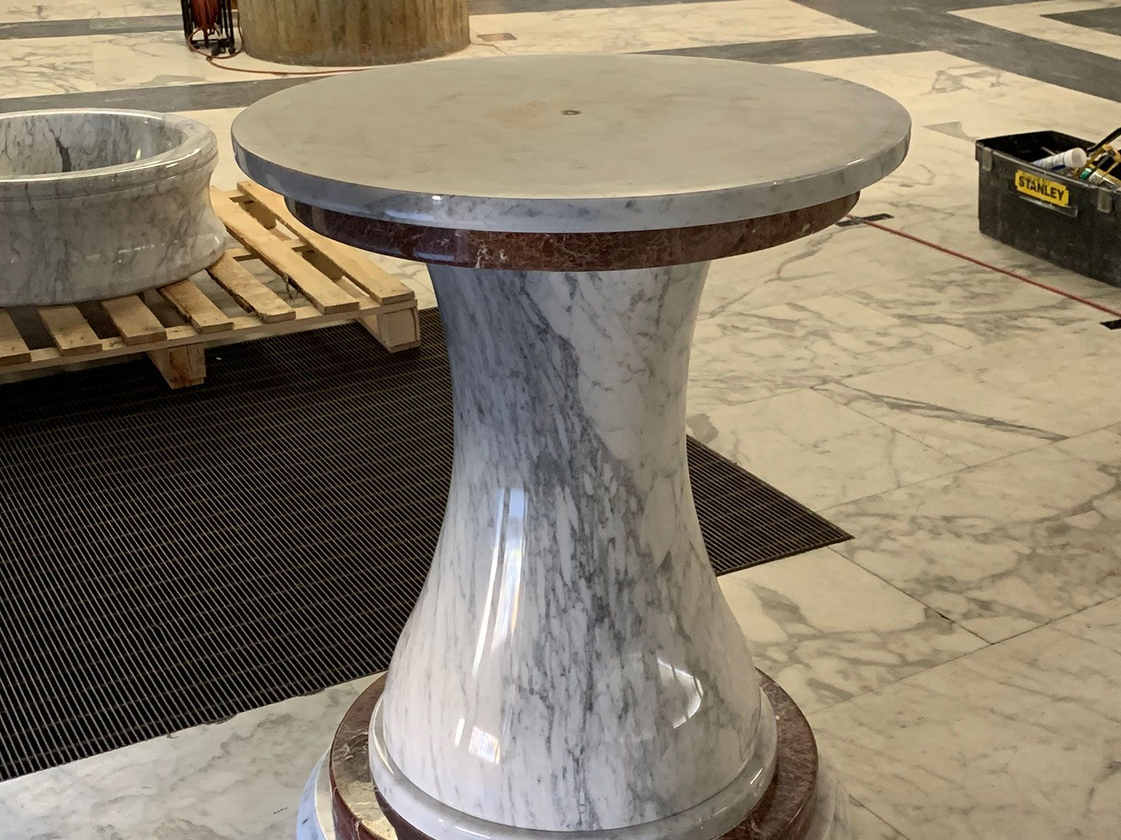 The marble pedestal of the holy water stoup