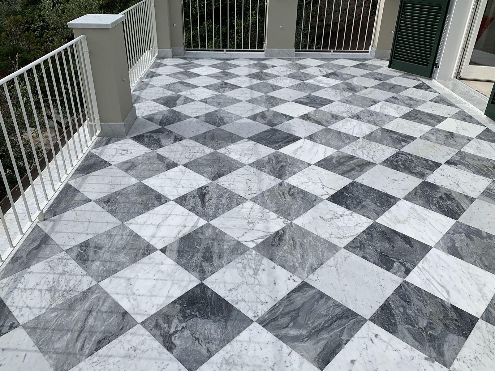 Terrace in white Carrara marble